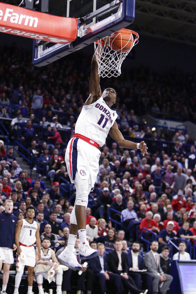 Gonzaga guard Joel Ayayi (11) dunks during the second half of an NCAA college basketball game against North Carolina in Spokane, Wash., Wednesday, Dec. 18, 2019. Gonzaga won 94-81. (AP Photo/Young Kwak)