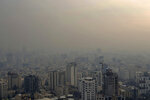 Air pollution blankets the skyline in Tehran, Iran, Wednesday, Dec 23, 2020. Iran's capital and its major cities have been plunged into darkness as rolling outages in recent weeks left millions with no electricity for hours. With toxic smog blanketing the skies in Tehran and the country buckling under the strain of the pandemic and sanctions targeting Iran's oil and gas industry, speculation about the spate of blackouts gripped social media. Soon, fingers pointed at an unlikely culprit: Bitcoin. (AP Photo/Ebrahim Noroozi)