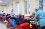 People donate blood for Gdansk Mayor Adamowicz, who is in critical condition and needs blood transfusions after being stabbed in the heart and abdomen on stage during a charity event the evening before, in Gdansk, Poland, Monday Jan. 14, 2019. Doctors operated for five hours on Adamowicz after an ex-convict rushed onto the stage with a knife, carried out the attack and shouted it was political revenge against a political party Adamowicz previously belonged to. (Krzysztof Mystkowski / KFP via AP) POLAND AUT