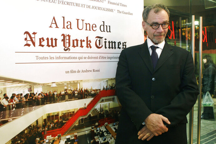 FILE - In this Nov. 21, 2011 file photo, New York Times journalist David Carr poses for a photograph as he arrives for the French premiere of the documentary