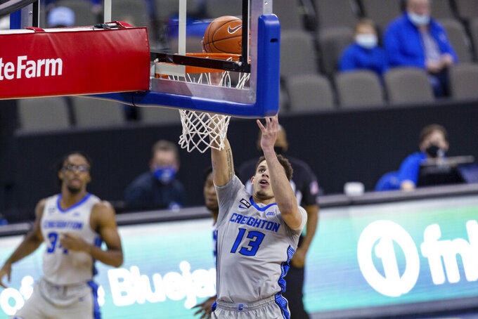 Creighton forward Christian Bishop (13) makes a layup against Seton Hall during the first half of an NCAA college basketball game Wednesday, Jan. 6, 2021, in Omaha, Neb. (AP Photo/John Peterson)