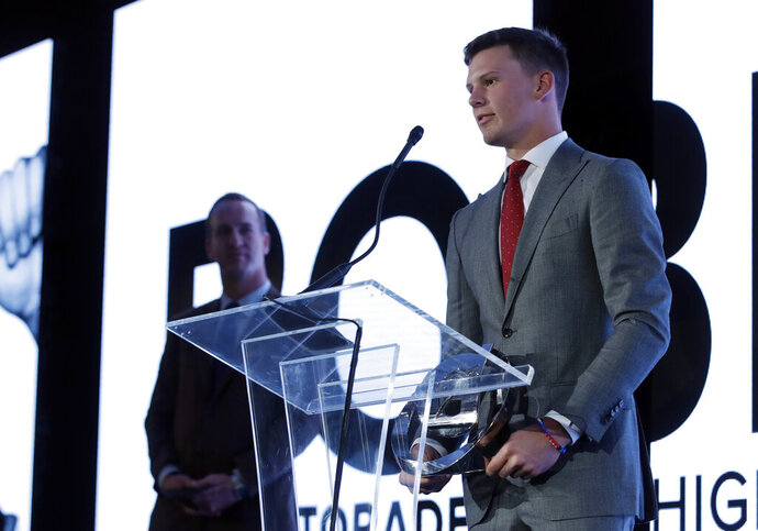 Bobby Witt Jr., a baseball player for Colleyville Heritage High School in Colleyville, Tex, accepts the award for High School Athlete of the Year at an awards banquet Tuesday, July 9, 2019, in Los Angeles. (AP Photo/Marcio Jose Sanchez)