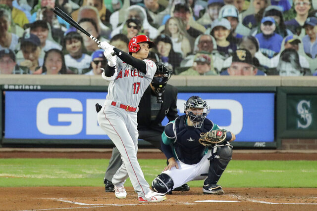 Los Angeles Angels' Shohei Ohtani (17) watches his solo home run as Seattle Mariners catcher Joe Hudson, right, looks on during the second inning of a baseball game Thursday, Aug. 6, 2020, in Seattle. (AP Photo/Ted S. Warren)