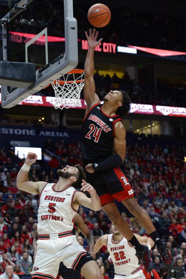 Louisville forward Dwayne Sutton (24) reaches for a rebound over Western Kentucky guard Camron Justice (5) during the first half of an NCAA college basketball game Friday, Nov. 29, 2019, in Nashville, Tenn. (AP Photo/Mark Zaleski)