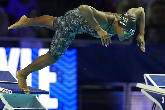 Simone Manuel participates in the women's 50 freestyle during wave 2 of the U.S. Olympic Swim Trials on Saturday, June 19, 2021, in Omaha, Neb. (AP Photo/Charlie Neibergall)