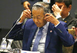 Malaysian Prime Minister Mahathir Mohamad puts on his headset to listen to speeches during the ASEAN Plus China Summit in the ongoing 33rd ASEAN Summit and Related Summits Wednesday, Nov. 14, 2018 in Singapore. (AP Photo/Bullit Marquez)