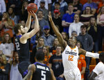 Kansas State forward Dean Wade (32) shoots over Oklahoma State forward Cameron McGriff (12) during the first half of an NCAA college basketball game in Stillwater, Okla., Saturday, Feb. 2, 2019. (AP Photo/Sue Ogrocki)