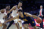 California guard Matt Bradley, right below, drives past Southern California guard Elijah Weaver, left, and forward Isaiah Mobley during the first half of an NCAA college basketball game in Los Angeles, Thursday, Jan. 16, 2020. (AP Photo/Alex Gallardo)