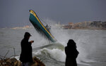 Palestinian fishermen ride their boat amid high waves on windy and rainy day at the sea in Gaza City, Sunday, Feb. 9, 2020. (AP Photo/Hatem Moussa)