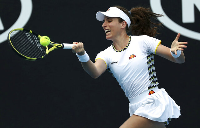 Johanna Konta of Britain makes a forehand return to Tunisia's Ons Jabeur during their first round singles match at the Australian Open tennis championship in Melbourne, Australia, Tuesday, Jan. 21, 2020. (AP Photo/Dita Alangkara)