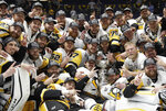 FILE - In this June 11, 2017, file photo, Pittsburgh Penguins players celebrate after defeating the Nashville Predators 2-0 in Game 6 of the NHL hockey Stanley Cup Final in Nashville, Tenn. The ebb and flow of recent champions from fast and skilled to physical and punishing illustrates how many different blueprints there are to win a championship in today's NHL and the importance of tailoring style of play to personnel and perfecting that chemistry. (AP Photo/Mark Humphrey, File)