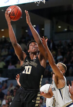 Wake Forest forward Jaylen Hoard (10) goes up for a shot as Georgia Tech guard Brandon Alston (4) defends during the second half of an NCAA college basketball game, Saturday, Jan. 5, 2019, in Atlanta.  (AP Photo/John Bazemore)
