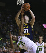 West Virginia forward Logan Routt (31) pulls down a rebound over Baylor guard Mark Vital (11) in the first half of an NCAA college basketball game, Saturday, Feb. 23, 2019, in Waco, Texas. (Rod Aydelotte/Waco Tribune Herald, via AP)/Waco Tribune-Herald via AP)