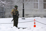 A Vermont State Police trooper guards the Statehouse in Montpelier, Vt., on Wednesday, Jan. 20, 2021. Gov. Phil Scott said Tuesday he was unaware of any specific threat to the Statehouse. (AP Photo/Wilson Ring)