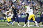 Seattle Seahawks quarterback Geno Smith (7) passes against the Los Angeles Chargers during the first half of an NFL football preseason game, Saturday, Aug. 28, 2021, in Seattle. (AP Photo/John Froschauer)