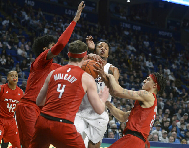 Penn State's Lamar Stevens (11) is fouled by Rutgers Ron Harper Jr., right, and Paul Mulcahy, center, during the first half of an NCAA college basketball game, Wednesday, Feb. 26, 2020, in State College, Pa. (AP Photo/Gary M. Baranec)