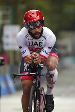Cyclist Fernando Gaviria attends the 14th stage of the Giro d'Italia cycling race, for the individual time trial from Conegliano to Valdobbiadene, Italy, on Saturday, Oct. 17, 2020. Colombian sprinter Gaviria is the latest cyclist to test positive for the coronavirus and be withdrawn from the Giro d'Italia. Gaviria and a staff member for Team AG2R La Mondiale were the only positives out of 492 tests carried out Sunday and Monday, Oct. 19, 2020. (Gian Mattia D'Alberto/LaPresse via AP)