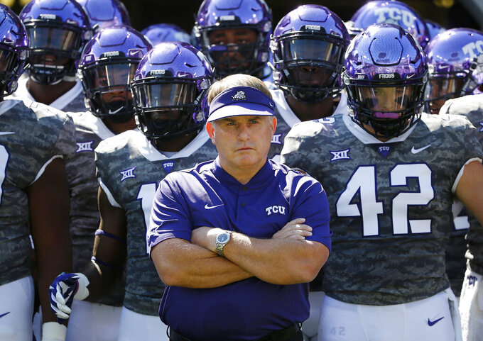 FILE - In this Saturday, Sept. 1, 2018, file photo, TCU head coach Gary Patterson stands with his team in the tunnel exit before running onto the field for an NCAA college football game against Southern University in Fort Worth, Texas. Coach Patterson is entering his 19th season at TCU coming off a 7-6 record that included an impressive late comeback, winning their last two regular season games just to get bowl eligible, and then won that game, after a season filled with injuries to so many key players. On defense, they have to replace three NFL draft picks. (AP Photo/Ron Jenkins, File)