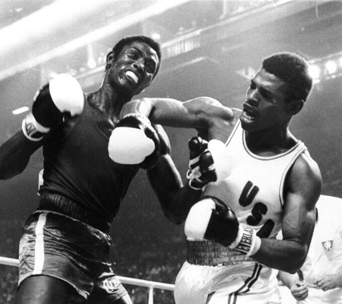FILE- In this July 31, 1976, file photo, the United States' Leon Spinks lets a right fly at the face of Cuba's Sixto Soria during light heavyweight boxing action at the Olympics in Montreal. Former heavyweight champion Leon Spinks Jr. died Friday night, Feb. 5, 2021, after battling prostate and other cancers. He was 67. (AP Photo/File)