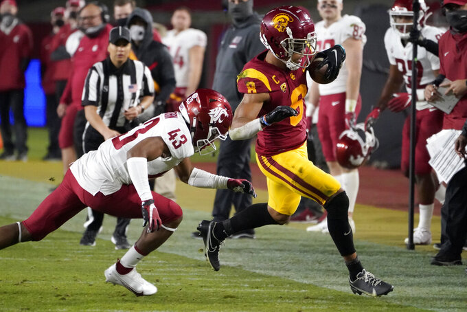 Southern California wide receiver Amon-Ra St. Brown, right, sprints away from Washington State defensive back Jamal McMurrin during the second half of an NCAA college football game in Los Angeles, Sunday, Dec. 6, 2020. (AP Photo/Alex Gallardo)