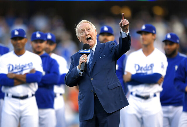 FILE - In this May 3, 2017, file photo, Los Angeles Dodgers broadcaster Vin Scully speaks during his induction into the team's Ring of Honor prior to a baseball game between the Dodgers and the San Francisco Giants in Los Angeles. Scully took a fall in his home Tuesday, April 21, 2020, and was taken to the hospital, where he was
