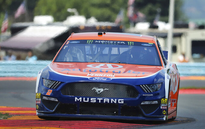 "Brad Keselowski (2) heads through the area known as ""The Bus Stop"" during a practice run for a NASCAR Cup Series auto race at Watkins Glen International, Saturday, Aug. 3, 2019, in Watkins Glen, N.Y. (AP Photo/John Munson)"