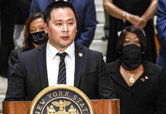 FILE - In this June 8, 2020, file photo, Assemblyman Ron Kim, D-Queens, speaks during a press briefing at the state Capitol in Albany, N.Y. Kim, one of the loudest voices calling for Gov. Andrew Cuomo to be impeached as the governor faces scandals revolving around the classification of nursing home deaths and allegations of sexual harassment, tested positive for COVID-19. (AP Photo/Hans Pennink, File)