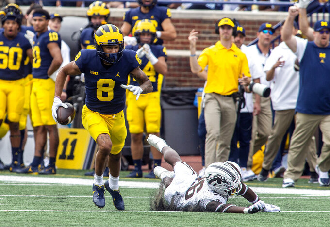 Michigan wide receiver Ronnie Bell (8) beats Western Michigan safety Delano Ware (26) to a reception and rushes in for a touchdown in the second quarter of an NCAA college football game in Ann Arbor, Mich., Saturday, Sept. 4, 2021. (AP Photo/Tony Ding)