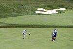 Matthew Fitzpatrick, of England, hits to the 14th green during opening round of the Workday Charity Open golf tournament, Thursday, July 9, 2020, in Dublin, Ohio. (AP Photo/Darron Cummings)