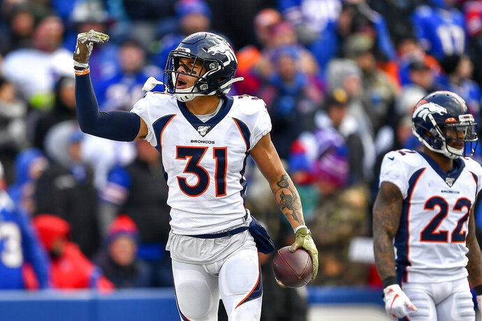 FILE - In this Sunday, Nov. 24, 2019 file photo, Denver Broncos free safety Justin Simmons (31) reacts against the Buffalo Bills during the second quarter of an NFL football game in Orchard Park, N.Y. Justin Simmons had an eventful offseason, finding his voice during peaceful protests of racial and social injustice from his hometown in Florida to downtown Denver. The fifth-year safety and first-time All-Pro also failed to reach agreement on a long-term contract with the Broncos, so he's playing under the franchise tag in 2020.(AP Photo/Adrian Kraus, File)