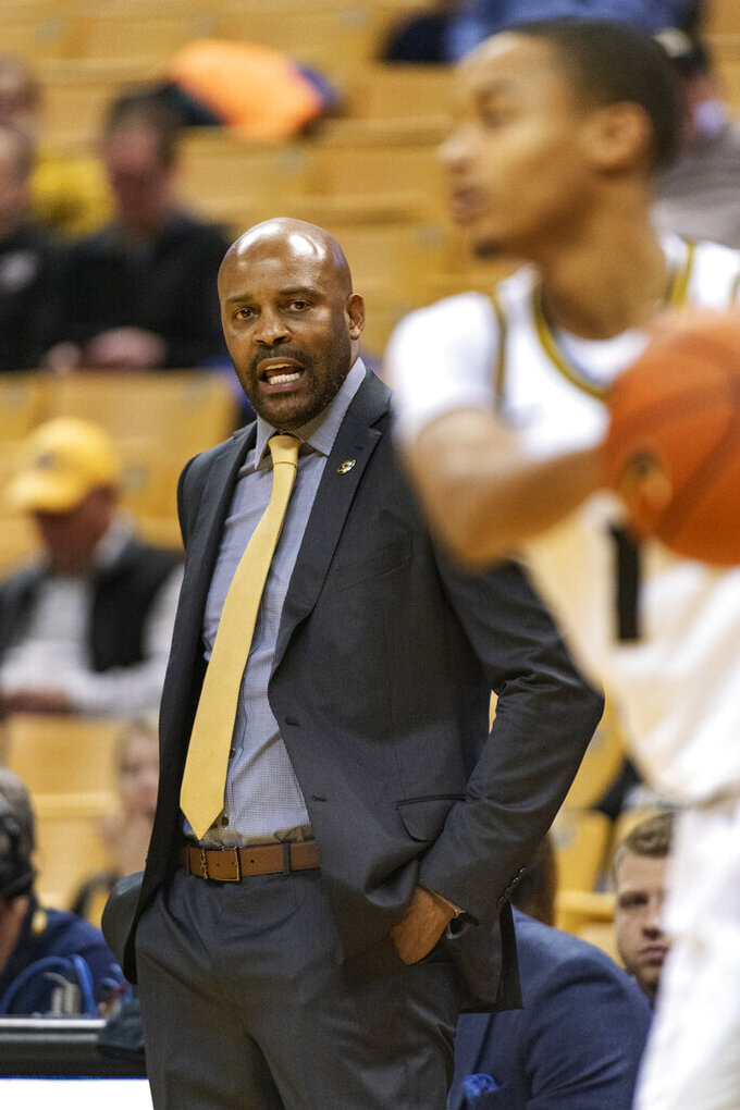 Missouri head coach Cuonzo Martin, left, calls a play during the first half of an NCAA college basketball game against Southern Illinois, Sunday, Dec. 15, 2019, in Columbia, Mo. (AP Photo/L.G. Patterson)