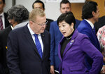 IOC member John Coates, left, meets Tokyo Governor Yuriko Koike prior to the start of the Four-Party Representative Meeting in Tokyo Friday, Nov. 1, 2019. Next year's Olympic marathons and race walks will be run in the northern city of Sapporo as the IOC has followed through with a controversial plan to move from Tokyo to the cooler northern city. (Kimimasa Mayama /Pool Photo via AP)