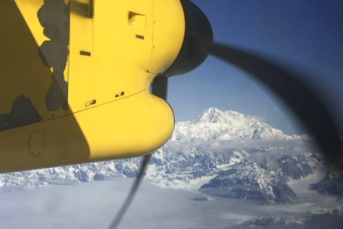 FILE - This May 10, 2017 file photo shows Denali, North America's tallest peak, from an airplane flying over the Alaska Range near Talkeetna, Alaska. Officials on Monday, April 5, 2021, said five people had to ski to a shelter after they landed on Ruth Glacier at the base of Denali on April 2, 2021, and a heavy snowstorm stranded them for at least three days. (AP Photo/Mark Thiessen, File)