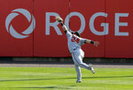 Baltimore Orioles outfielder DJ Stewart makes a leaping catch on Toronto Blue Jays Bo Bichette during the first inning of a baseball game, Sunday, Sept. 27, 2020, in Buffalo, N.Y. (AP Photo/Jeffrey T. Barnes)