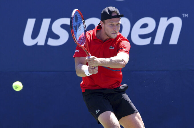 FILE - In this Aug. 29, 2019, file photo, Denis Kudla, of the United States, returns a shot to Dusan Lajovic, of Serbia, during the second round of the U.S. Open tennis championships in New York. Some professional tennis players and coaches are having a hard time financially right now because of the coronavirus pandemic. Unlike their counterparts in team sports, they do not have regular salaries. (AP Photo/Sarah Stier, File)