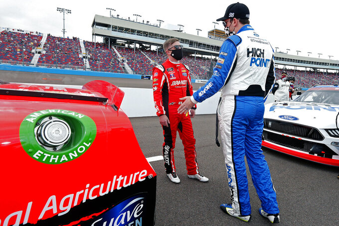 Justin Allgaier, left, and Chase Briscoe talk on pit road prior to the NASCAR Xfinity Series auto race at Phoenix Raceway, Saturday, Nov. 7, 2020, in Avondale, Ariz. (AP Photo/Ralph Freso)