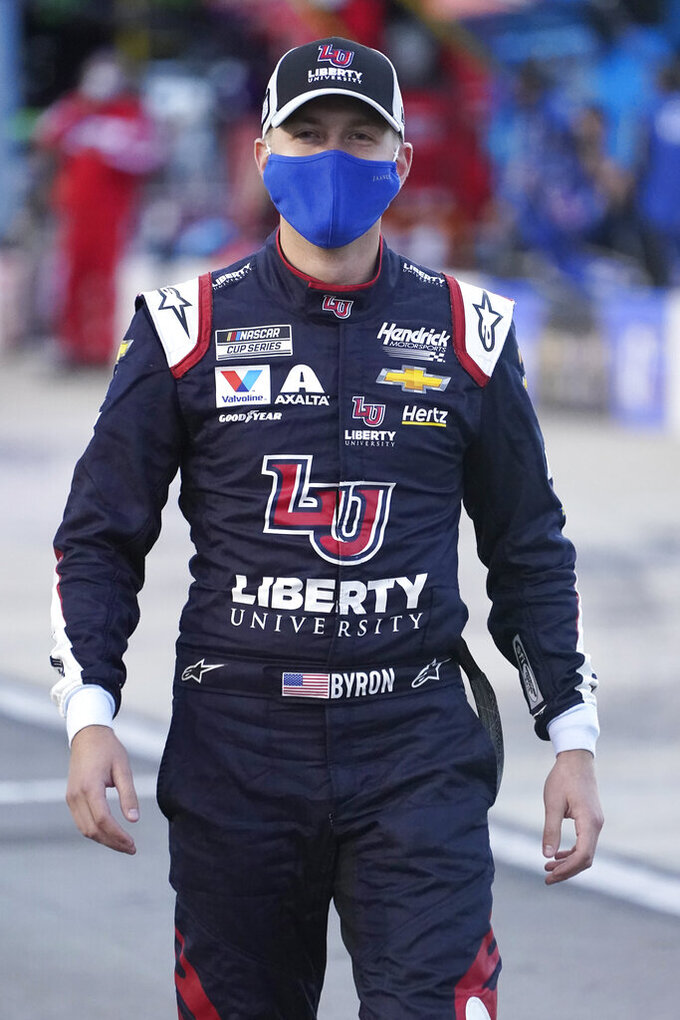 William Byron walks to his car prior to the start of a NASCAR Cup Series auto race Saturday, Sept. 12, 2020, in Richmond, Va. (AP Photo/Steve Helber)