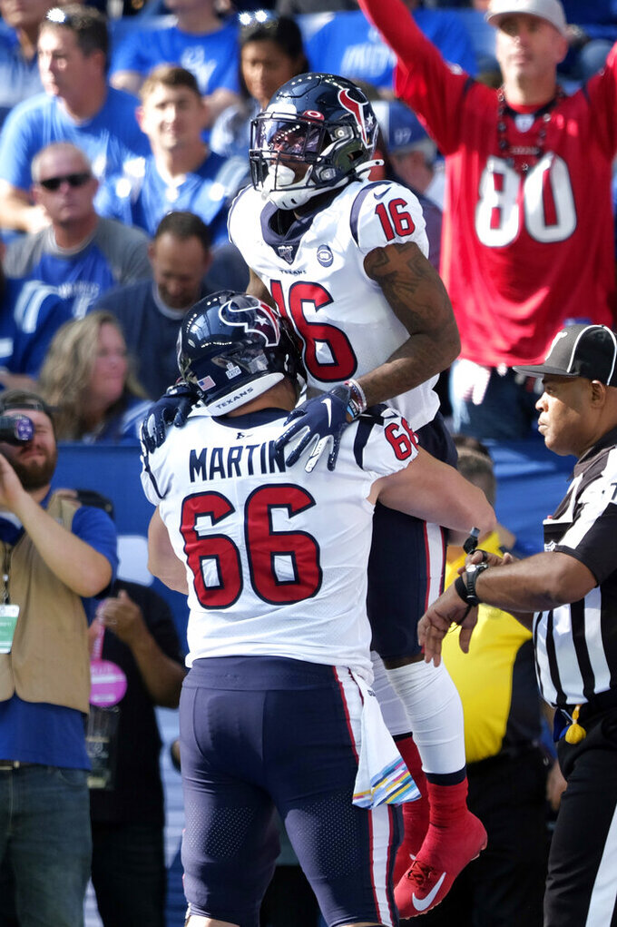Houston Texans' Keke Coutee (16) celebrates with teammate Nick Martin after scoring a touchdown during the second half of an NFL football game against the Indianapolis Colts, Sunday, Oct. 20, 2019, in Indianapolis. (AP Photo/AJ Mast)
