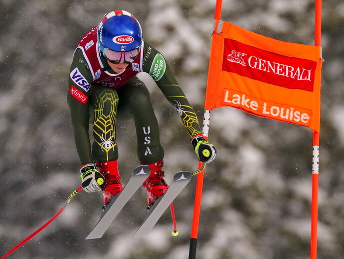FILE - In this Dec. 7, 2019, file photo, Mikaela Shiffrin races down the course during the women's World Cup downhill ski race, in Lake Louise, Alberta. The governing body for ski racing announced it will skip the traditional World Cup swing through North America to remain in Europe due to the COVID-19 pandemic. The women's side will miss stops in Killington, Vermont, and Lake Louise, Alberta. The men's tour won't race in Beaver Creek, Colorado, or make a separate trip to Lake Louise. The venues are slated to be back on the calendar in 2021-22, according to the International Ski Federation. (Frank Gunn/The Canadian Press via AP, File)