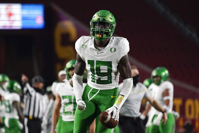 Oregon safety Jamal Hill (19) celebrates after a play during the first quarter of an NCAA college football game for the Pac-12 Conference championship against Southern California Friday, Dec 18, 2020, in Los Angeles. (AP Photo/Ashley Landis)