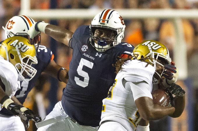 FILE - In this Sept. 8, 2018, file photo, Auburn defensive lineman Derrick Brown (5) stops Alabama State running back Tallesin Farmer during an NCAA college football game in Auburn, Ala. Auburn, which plays Oregon this week, has one of the top defensive lines, led by preseason All-America tackle Brown. (AP Photo/Vasha Hunt, File)