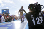 Jimmie Johnson slaps hands with fans during driver introductions before the NASCAR Daytona 500 auto race at Daytona International Speedway, Sunday, Feb. 16, 2020, in Daytona Beach, Fla. (AP Photo/Terry Renna)