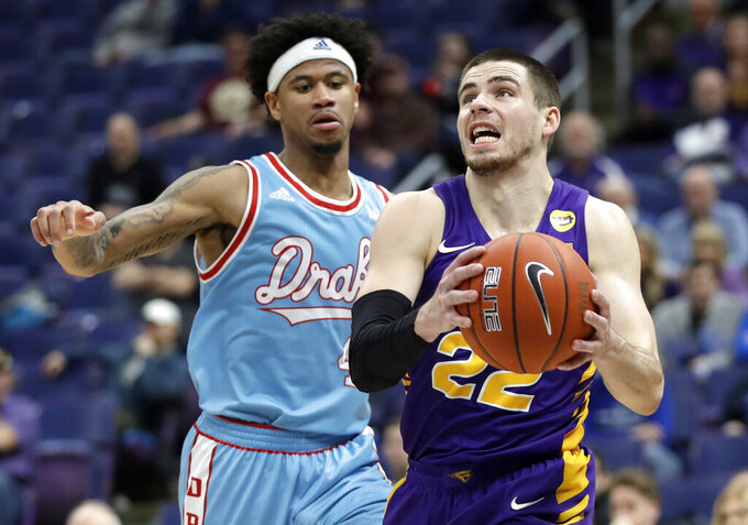 Northern Iowa's Wyatt Lohaus (22) heads to the basket past Drake's Anthony Murphy during the second half of an NCAA college basketball game in the semifinal round of the Missouri Valley Conference tournament, Saturday, March 9, 2019, in St. Louis. Northern Iowa won 60-58. (AP Photo/Jeff Roberson)