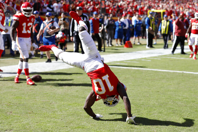 Kansas City Chiefs wide receiver Tyreek Hill (10) performs a flip after scoring a touchdown against the Houston Texans during the second half of an NFL football game in Kansas City, Mo., Sunday, Oct. 13, 2019. (AP Photo/Colin E. Braley)