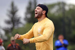 Cleveland Browns quarterback Baker Mayfield reacts after batting down a pass at the Baker Mayfield ProCamp in Gates Mills, Ohio, Wednesday, July 21, 2021.(Joshua Gunter/Cleveland.com via AP)