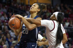 Temple guard Ashley Jones, right, blocks a shot by Connecticut forward Olivia Nelson-Ododa (20) during the first half of an NCAA college basketball game Sunday, Nov. 17, 2019, in Philadelphia. (AP Photo/Laurence Kesterson)