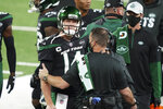 Trainers check on New York Jets quarterback Sam Darnold during the first half of the team's NFL football game against the Denver Broncos on Thursday, Oct. 1, 2020, in East Rutherford, N.J. (AP Photo/John Minchillo)