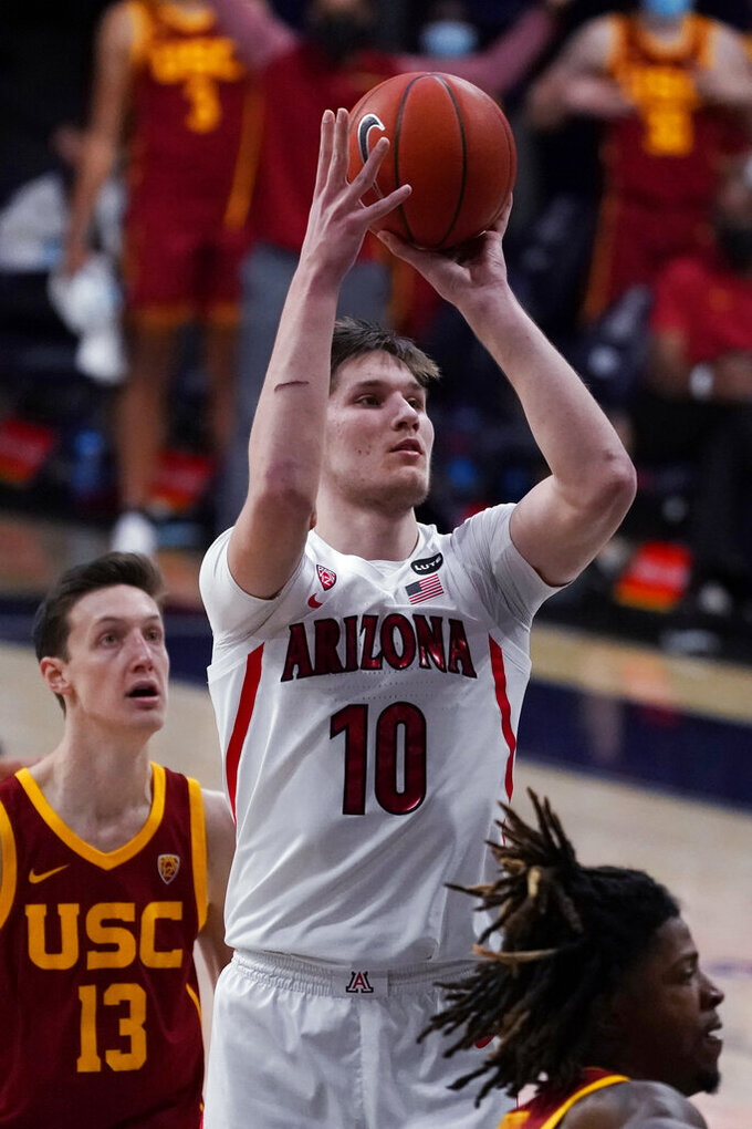 Arizona forward Azuolas Tubelis (10) shoots against Southern California during the second half of an NCAA college basketball game, Thursday, Jan. 7, 2021, in Tucson, Ariz. (AP Photo/Rick Scuteri)