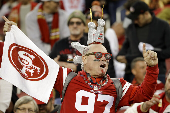 A San Francisco 49ers fans cheers during the second half of the NFL NFC Championship football game against the Green Bay Packers Sunday, Jan. 19, 2020, in Santa Clara, Calif. (AP Photo/Marcio Jose Sanchez)