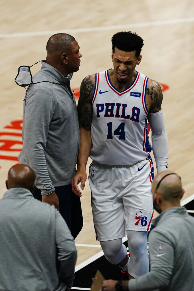 Philadelphia 76ers forward Danny Green (14) reacts as he walks off the court past head coach Doc Rivers, top left, before heading to the locker room, during the first half of Game 3 of a second-round NBA basketball playoff series against the Atlanta Hawks, Friday, June 11, 2021, in Atlanta. (AP Photo/John Bazemore)